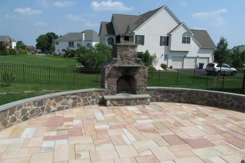 Outdoor Fireplace With Natural Stone Patio