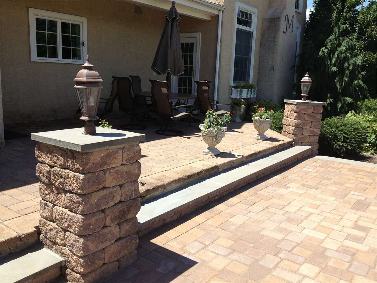 Beau EP Henry Patio With Fire Pit And Pillar Lights